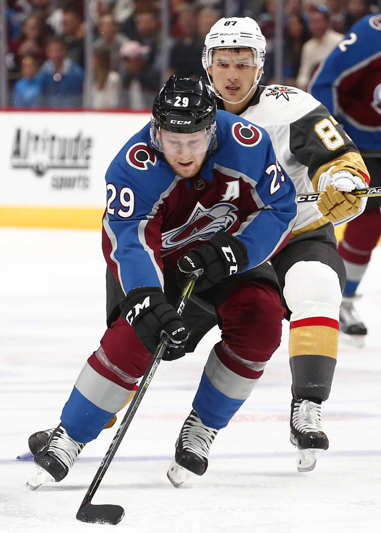 Colorado Avalanche center Nathan MacKinnon (29) moves the puck against Las Vegas Golden Knights center Vadim Shipachyov (87) during the first period of a preseason hockey game Tuesday, Sept. 19, 2 ...