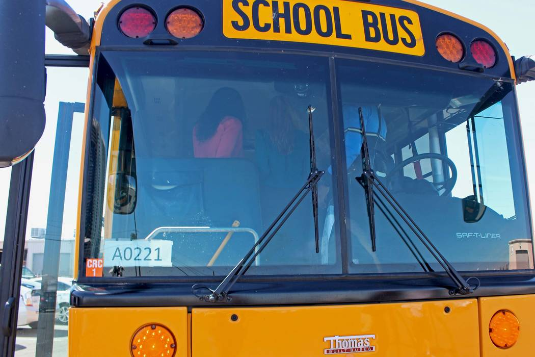 A Clark County School District bus was involved in a crash with a car Thursday morning. (Gabriella Benavidez/Las Vegas Review-Journal) @latina_ish