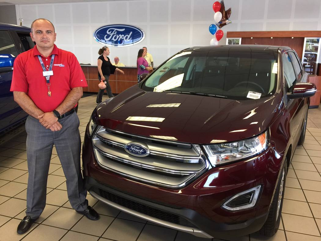 Friendly Ford Friendly Ford sales consultant Grig Demirchyan shows off the burgundy 2017 Ford Edge SEL at the dealership at 660 N. Decatur Blvd.