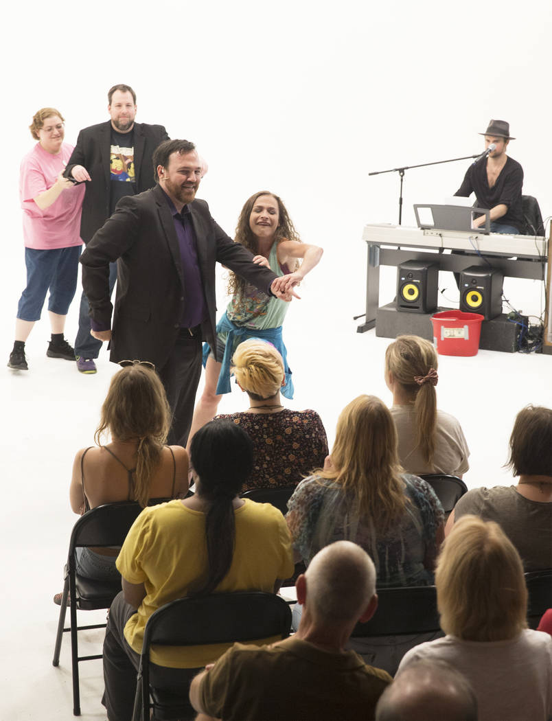 "Matt Donnelly, front/left, acts out a skit with audience member Sara Jo Dustan during filming of ""The Bucket Show"" on Wednesday, September 20, 2017, at OogOog Studio, in Las Vega ..."