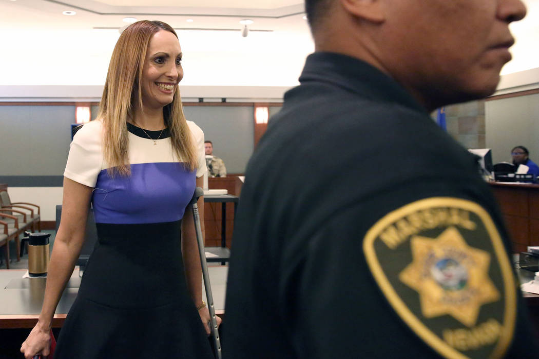 Alexis Plunkett smiles as she leaves the courtroom after a district judge dismissed the indictment against her at the Regional Justice Center on Thursday, Sept. 21, 2017, in Las Vegas. Plunkett wa ...