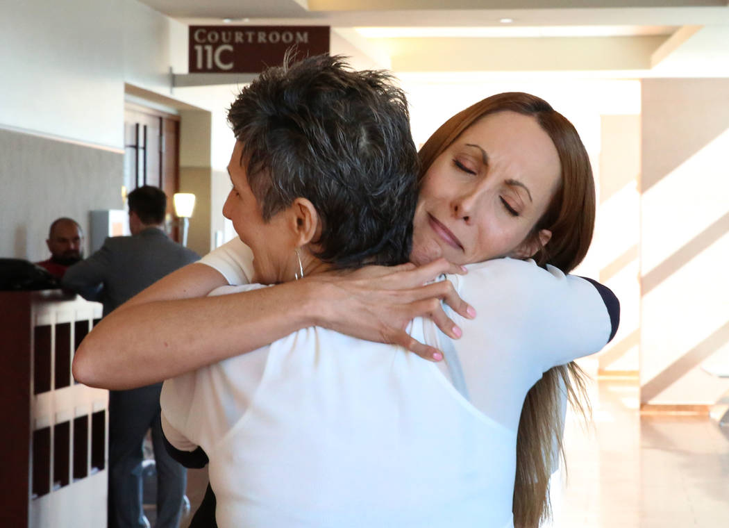 Alexis Plunkett, left, hugs her mother, who declined to give her name, after a district judge dismissed the indictment against Plunkett at the Regional Justice Center on Thursday, Sept. 21, 2017,  ...