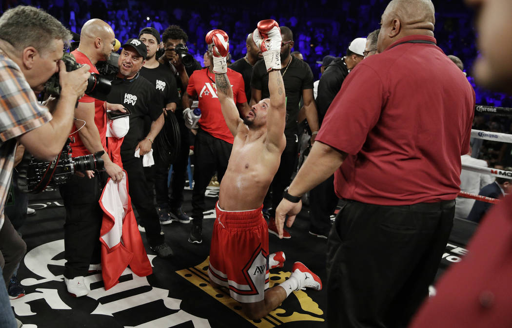 Andre Ward celebrates after defeating Sergey Kovalev during a light heavyweight championship boxing match in Las Vegas on June 17, 2017. Ward is retiring from boxing with an undefeated record beca ...