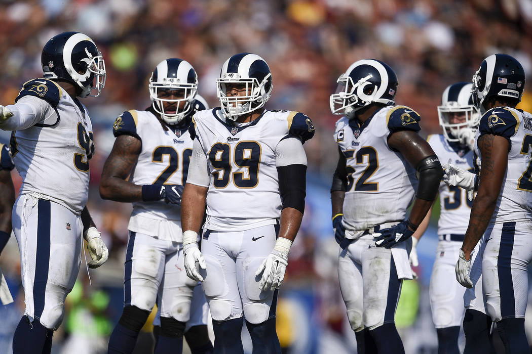 Los Angeles Rams defensive tackle Aaron Donald (99) stands with his team during the second half of an NFL football game against the Washington Redskins Sunday, Sept. 17, 2017, in Los Angeles. (AP  ...