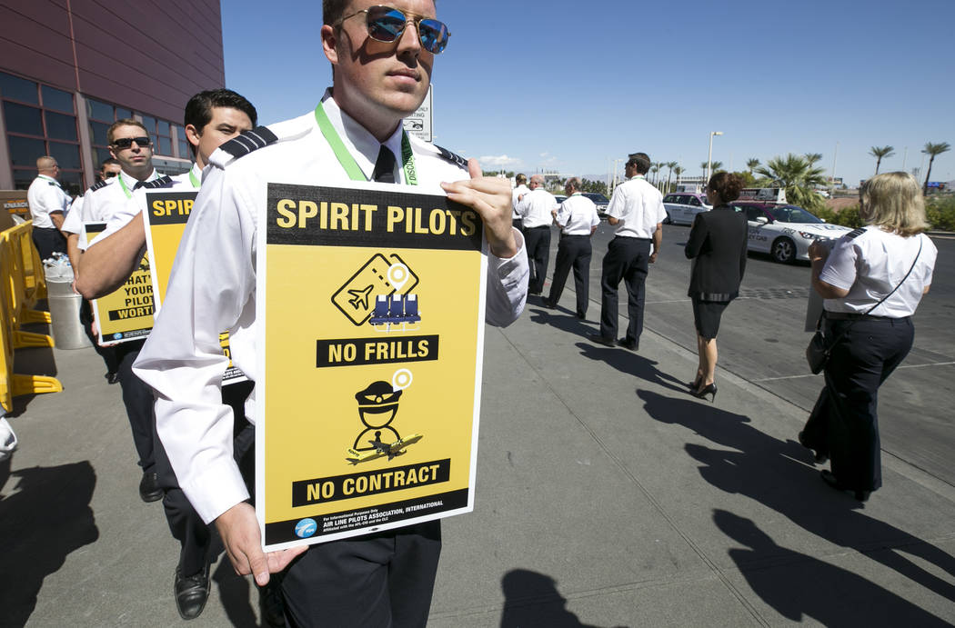 Pilots from Spirit Airlines and supporters picket in a designated area in front of McCarran International Airport's Terminal 1 on Friday, Sept. 22, 2017, in Las Vegas. Richard Brian Las Veg ...