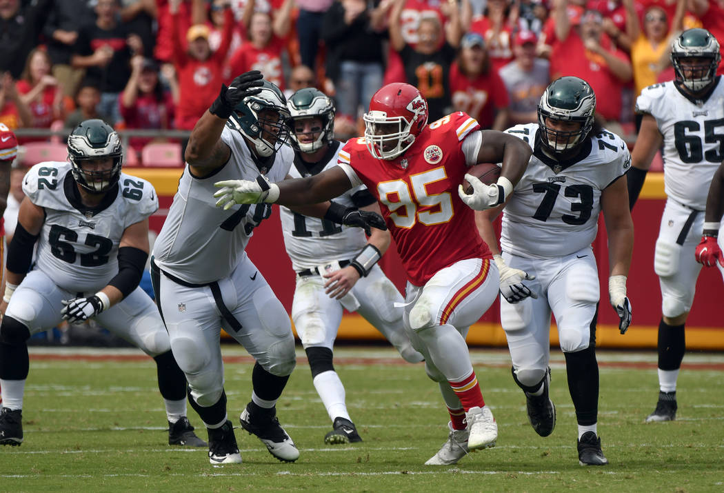 Kansas City Chiefs defensive lineman Chris Jones (95) is flanked by Philadelphia Eagles offensive guard Brandon Brooks (79) and offensive guard Isaac Seumalo (73) catching a deflected pass from Ph ...
