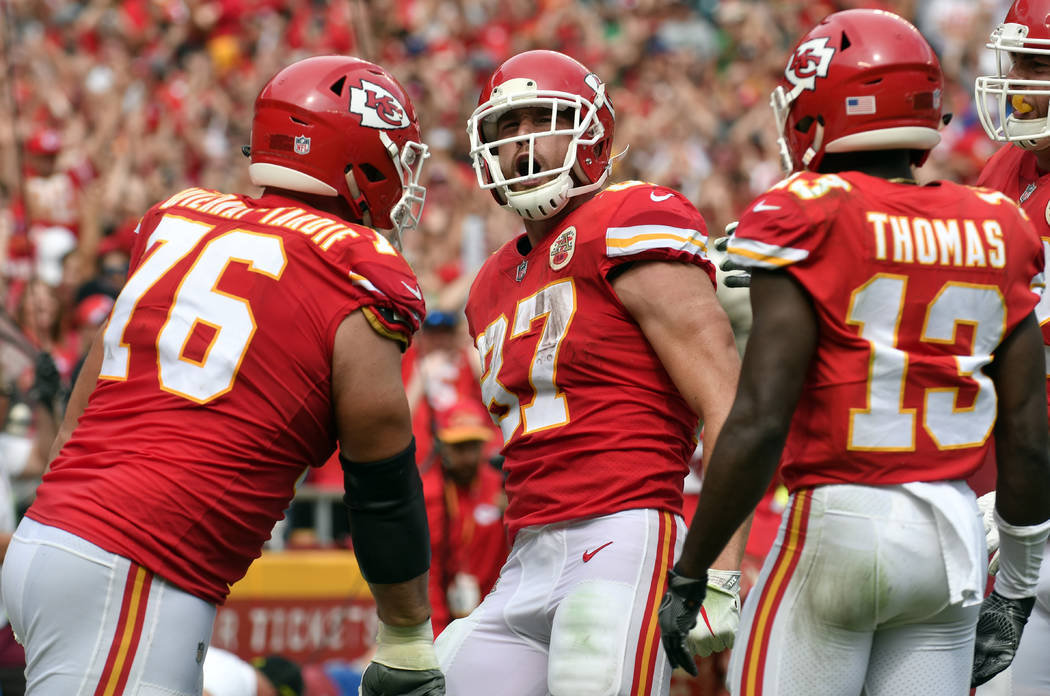 Kansas City Chiefs tight end Travis Kelce (87) celebrates his touchtown with teammates offensive lineman Laurent Duvernay-Tardif (76) and wide receiver De'Anthony Thomas (13) during the second hal ...