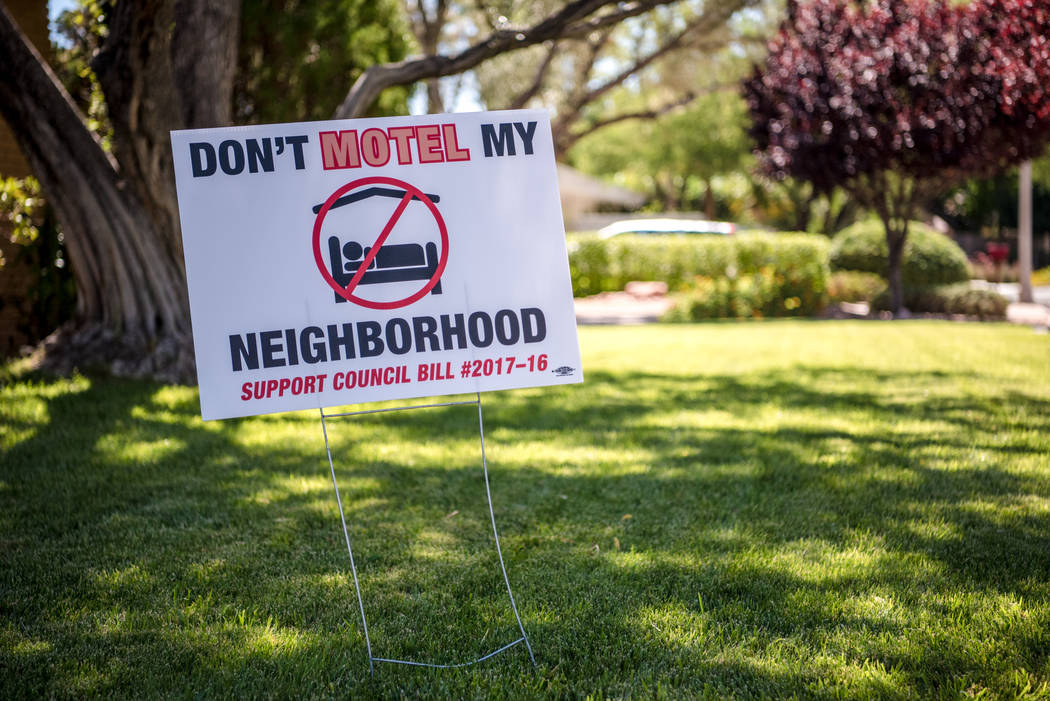 "Shadow Lane exhibiting their ""Don't Motel My Neighborhood"" signs on Wednesday, June 14, 2017, in Las Vegas. Morgan Lieberman Las Vegas Review-Journal"