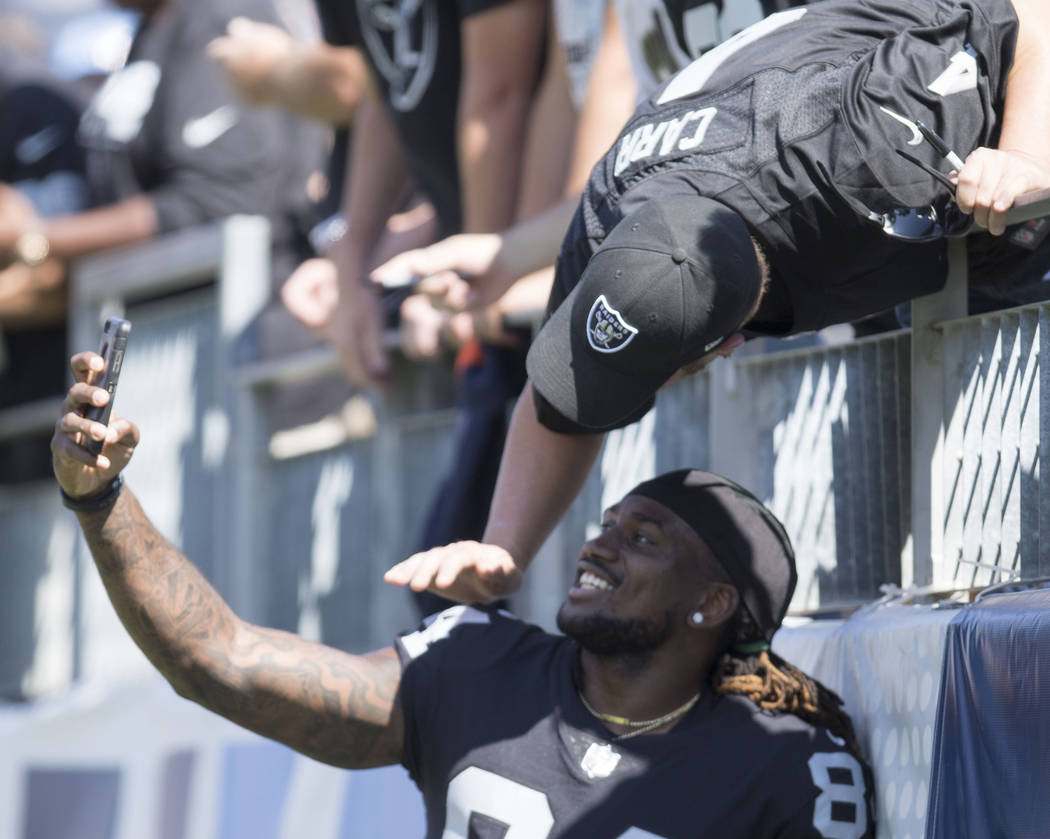 Oakland Raiders wide receiver Cordarrelle Patterson (84) takes a selfie with a fan before the team's game against the Tennessee Titans at the Nissan Stadium in Nashville, Tenn., Sunday, Sept. 10,  ...