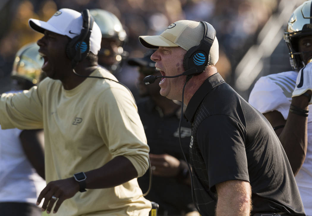 Purdue head coach Jeff Brohm calls plays from the sideline during the third quarter of an NCAA college football game against Missouri, Saturday, Sept. 16, 2017, in Columbia, Mo. (AP Photo/L.G. Pat ...