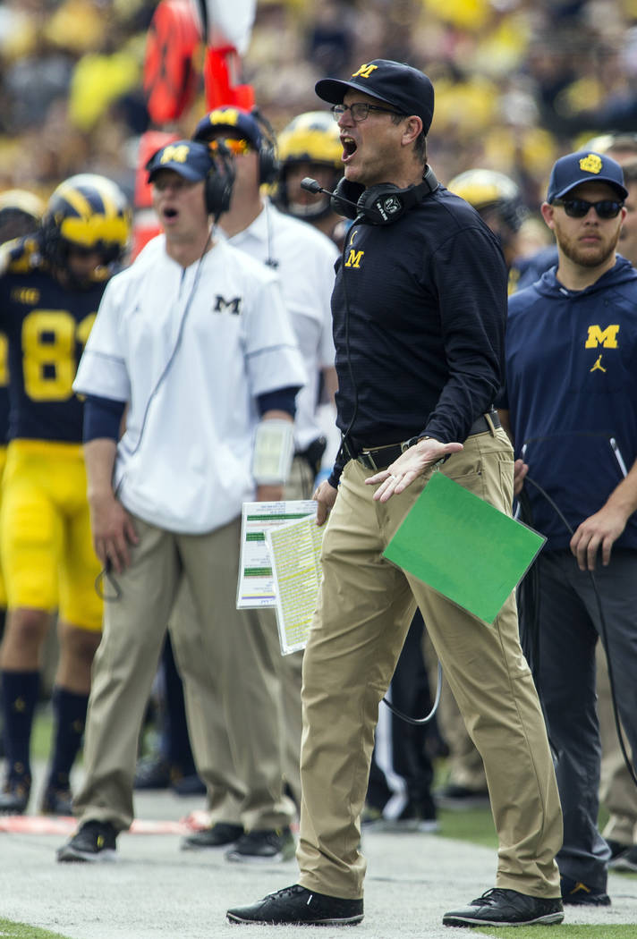 Michigan head coach Jim Harbaugh shouts at the referees from the sideline after a penalty called on Michigan in the third quarter of an NCAA college football game against Air Force in Ann Arbor, M ...