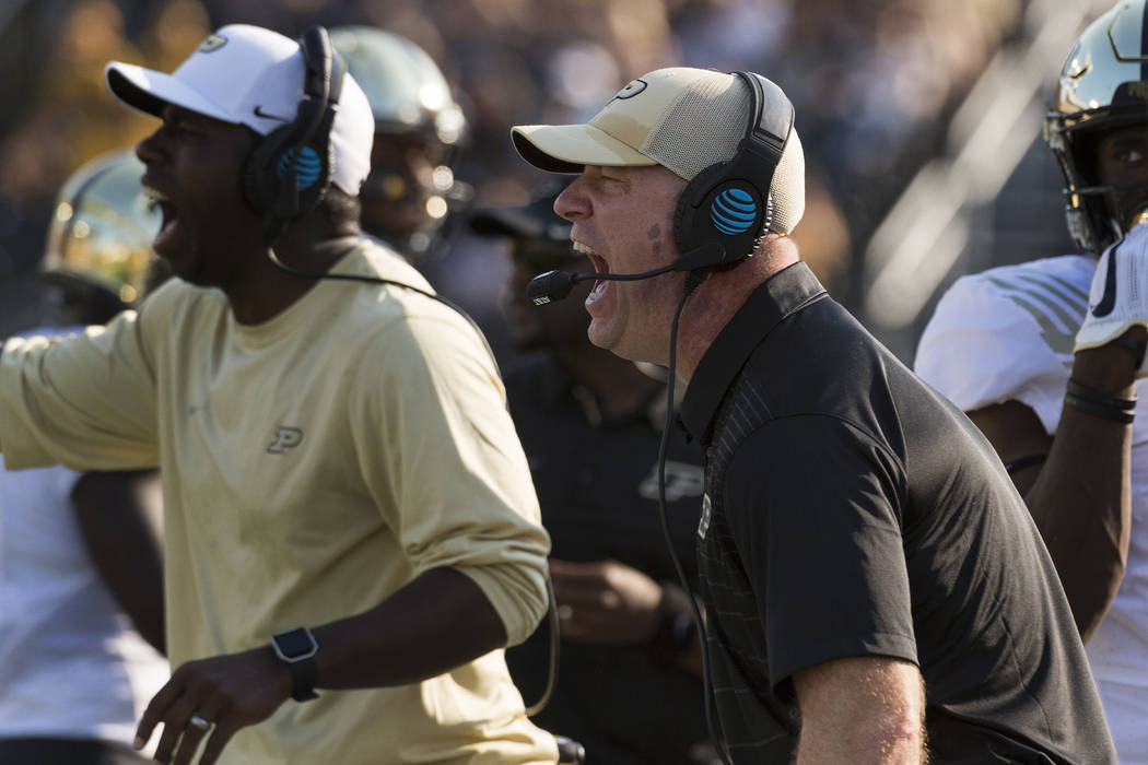 Purdue head coach Jeff Brohm, right, calls plays from the sideline during the third quarter of an NCAA college football game against Missouri, Saturday, Sept. 16, 2017, in Columbia, Mo. (AP Photo/ ...