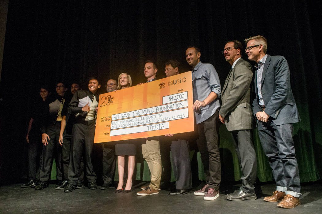 Representatives from Life is Beautiful and Toyota present Clark County School Districts a music grant at Clark High School on Thursday, Sept. 21, 2017, in Las Vegas. Morgan Lieberman Las Vegas Rev ...
