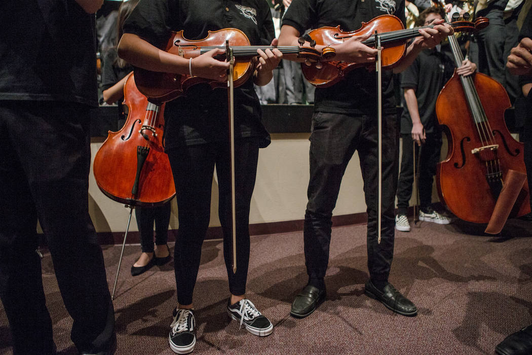Students of the Clark High School Orchestra play their violins like guitars before the Imagine Dragons special ceremony at Clark High School on Thursday, Sept. 21, 2017, in Las Vegas. Morgan Liebe ...