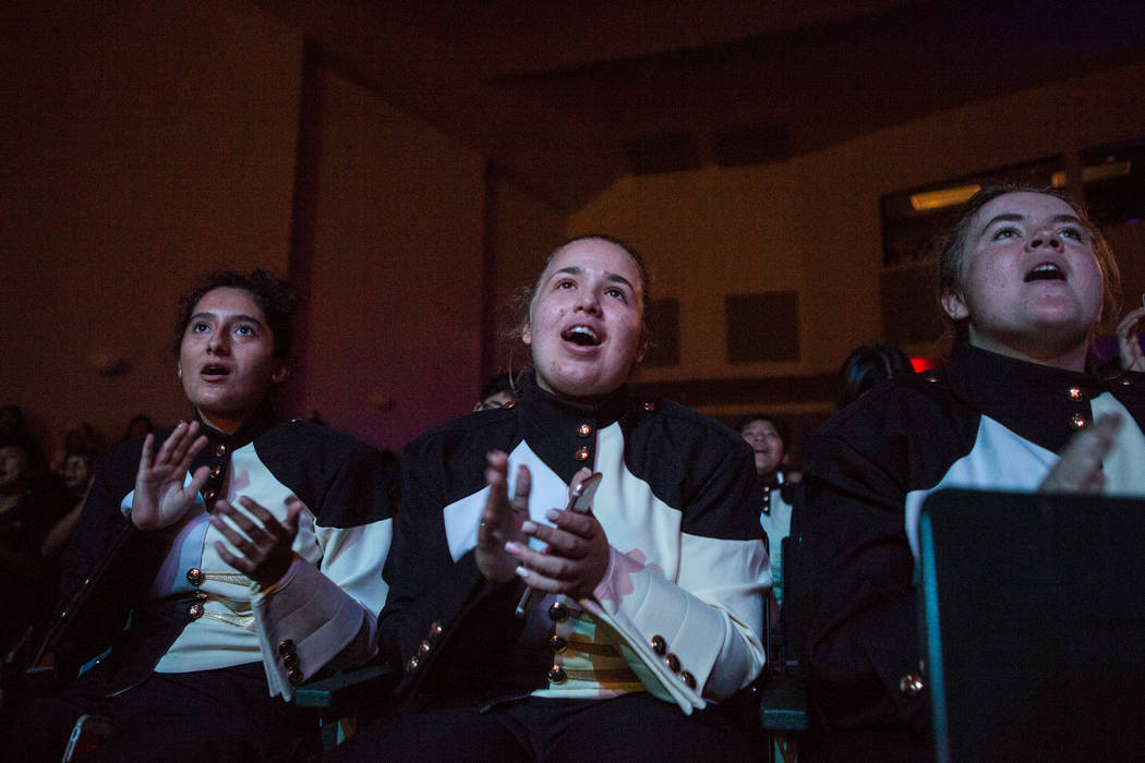 "Magaly Hernandez, left, Alexis Hazy, and Jessica Plummer sing to ""Demons,"" one of Imagine Dragon's most popular songs, during a special ceremony at Clark High School on Thursday, ..."