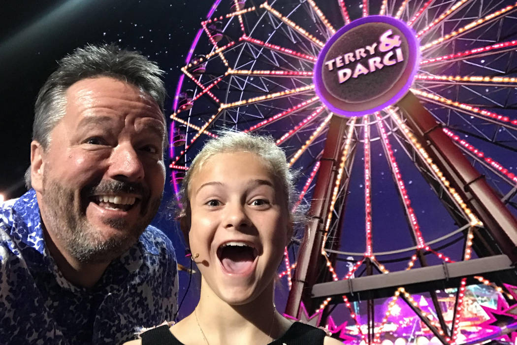 Darci Lynne Farmer taking a selfie with Terry Fator