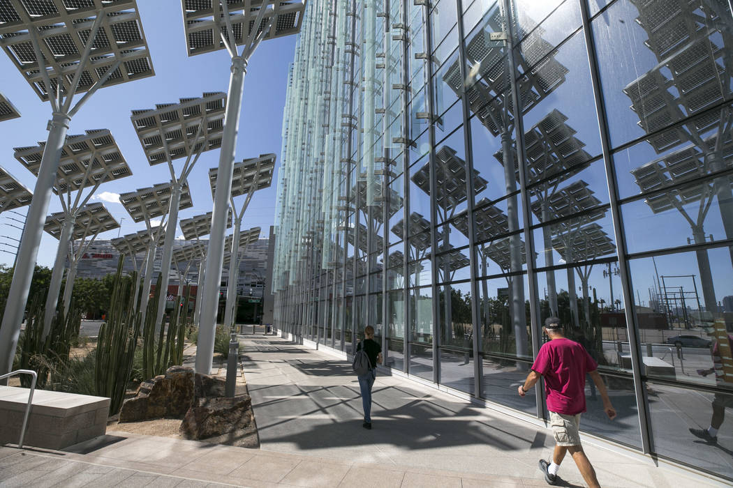 210697adca Rows of solar panels soak up the sun s rays outside Las Vegas City Hall in  downtown