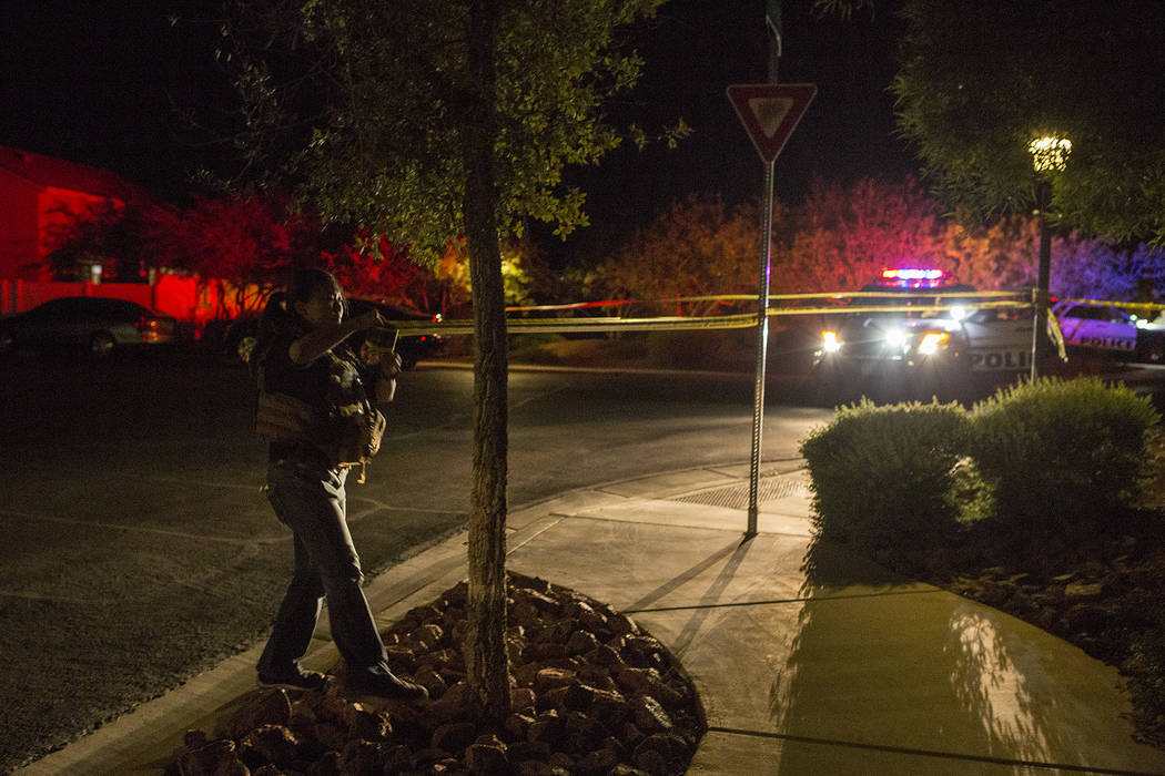 Officers are present in a northwest gated neighborhood near the intersection of North Fort Apache Road and West Grand Teton Drive on Thursday, Sept. 21, 2017, in Las Vegas.  Bridget Bennett Las Ve ...