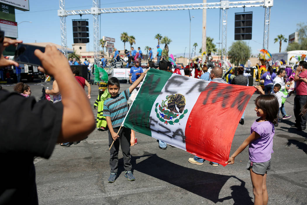 Yerick Aleman, 9, left, Jocelyn Aleman, 7, hold a Mexican flag during a Marianaճ Charity Foundation benefit for earthquake victims in Mexico supported by the Latin Chamber of Commerce at Mar ...