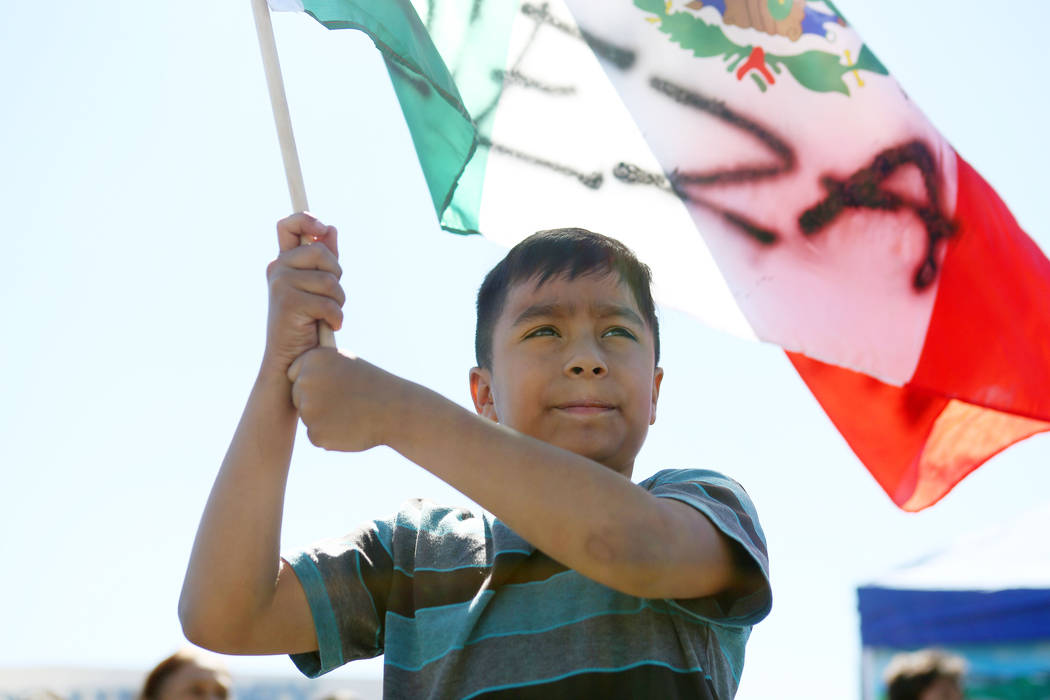 Yerick Aleman, 9,  holds a Mexican flag during a Marianaճ Charity Foundation benefit for earthquake victims in Mexico supported by the Latin Chamber of Commerce at Mariana's Supermarket on W ...