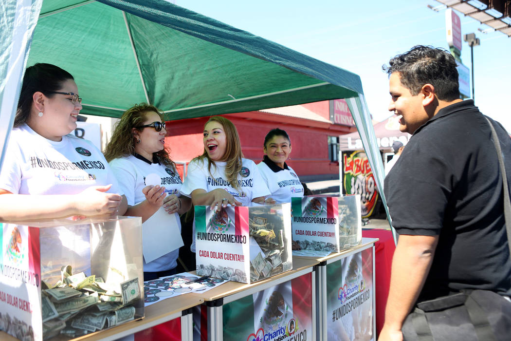 Donations are collected during a Marianaճ Charity Foundation benefit for earthquake victims in Mexico supported by the Latin Chamber of Commerce at Mariana's Supermarket on West Sahara Avenu ...