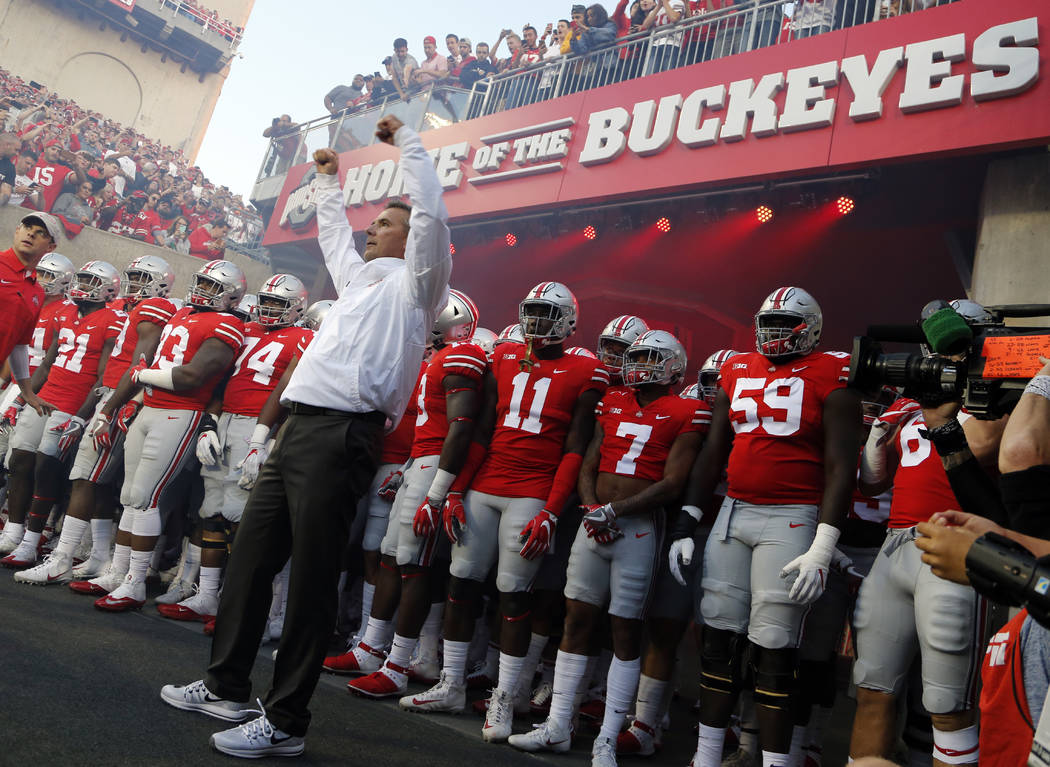 Ohio State head coach Urban Meyer leads his team onto the field before the start of their NCAA college football game against Oklahoma Saturday, Sept. 9, 2017, in Columbus, Ohio. (AP Photo/Jay LaPrete)