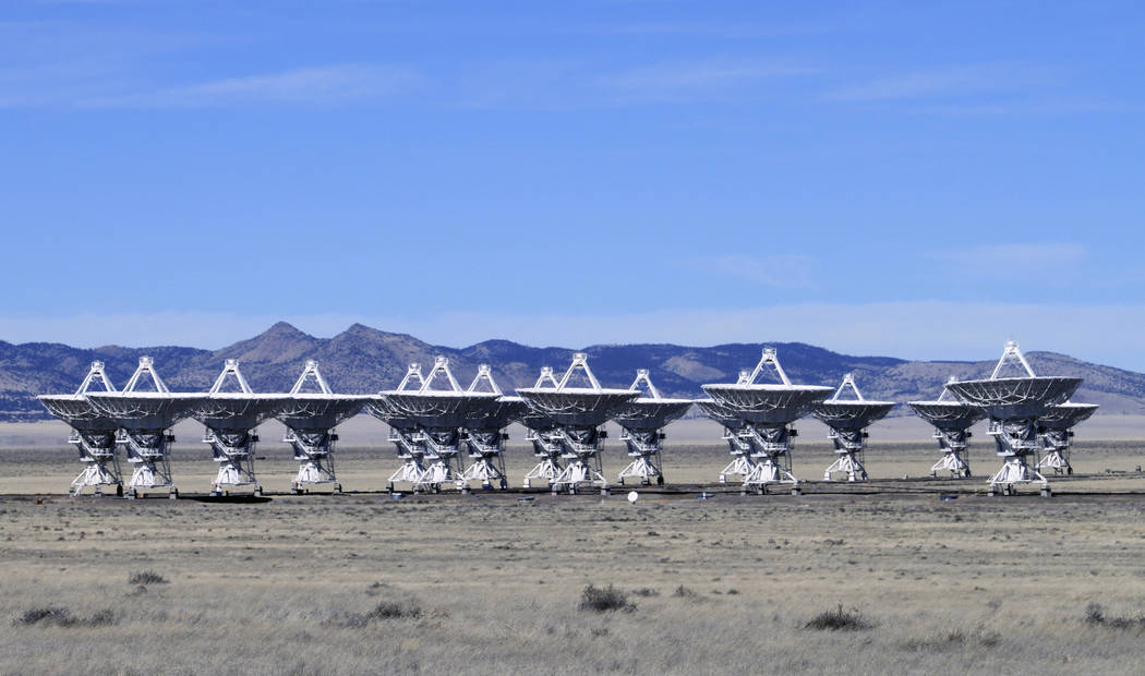 This Feb. 10, 2017 photo shows radio antennas that make up the Very Large Array astronomical observatory are positioned on tracks on the Plains of San Augustin west of Socorro, N.M. (AP Photo/Susa ...