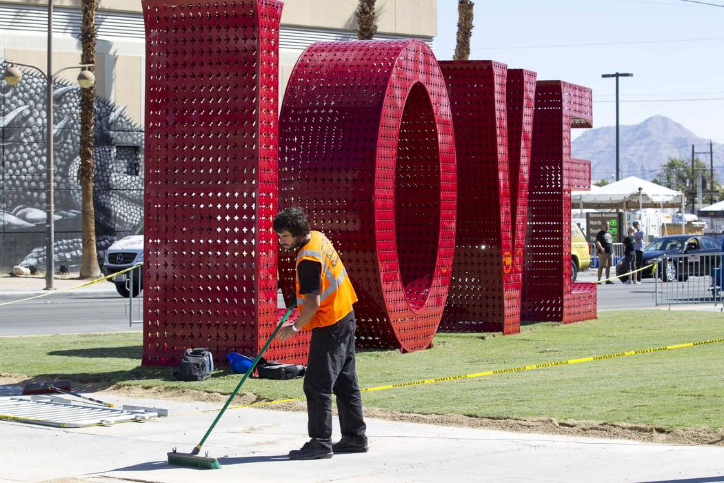 A worker sweeps the sidewalk as preparations continue on the festival grounds of Life is Beautiful in downtown Las Vegas, Thursday, Sept. 21, 2017. (Richard Brian/Las Vegas Review-Journal) @vegasp ...