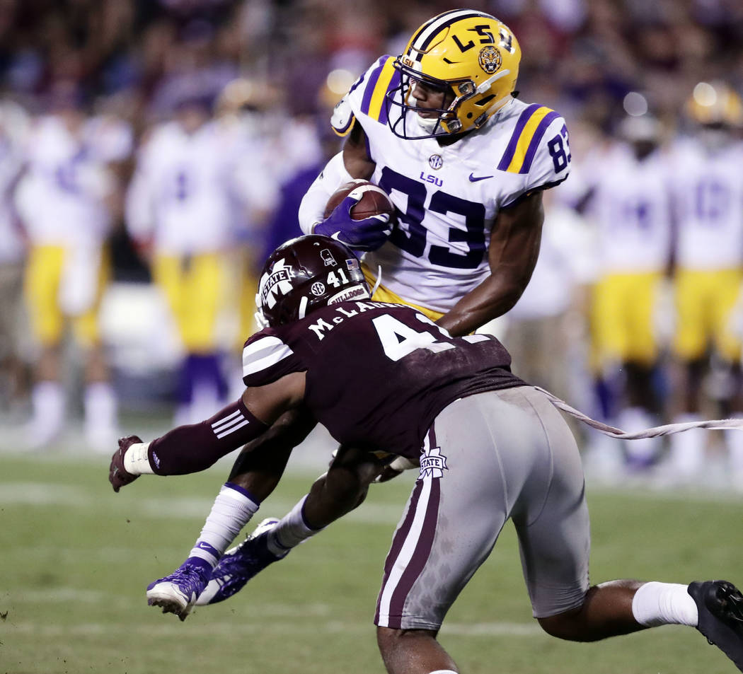 LSU wide receiver Russell Gage (83) is upended by Mississippi State defensive back Mark McLaurin (41) after catching a shot yardage pass during the second half of their NCAA college football game  ...