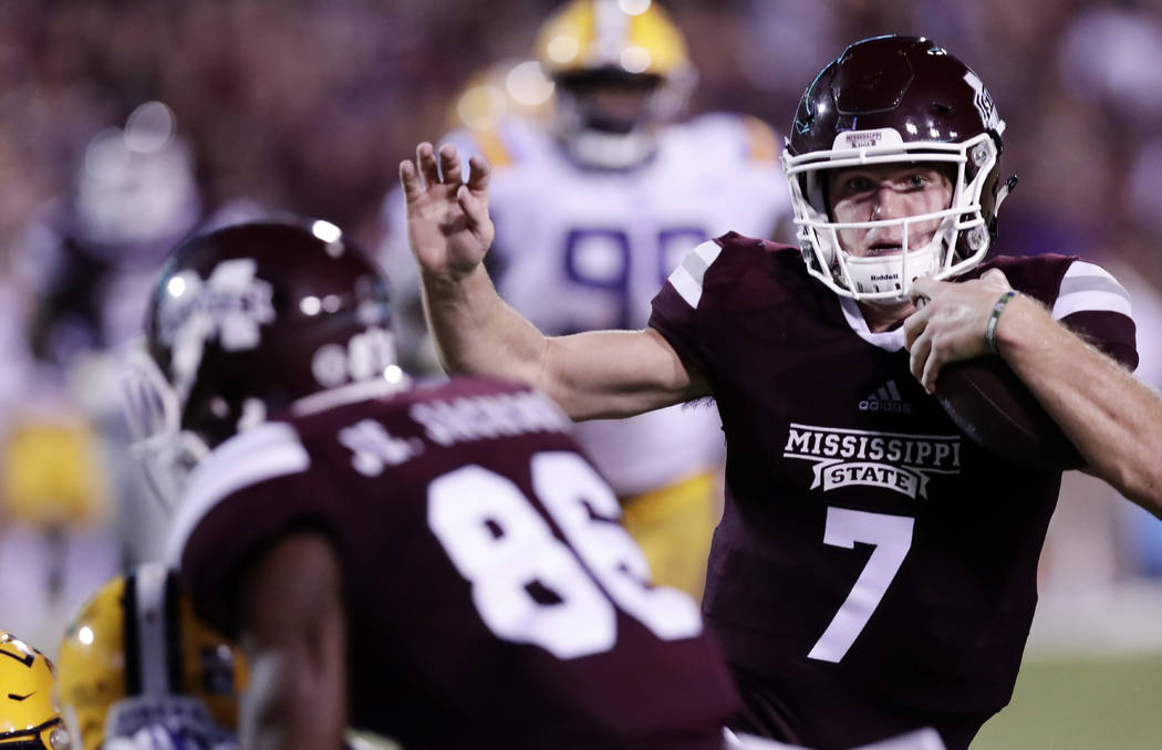 Mississippi State quarterback Nick Fitzgerald (7) uses the blocking of wide receiver Jesse Jackson (86) during the second half of their NCAA college football game against LSU in Starkville, Miss., ...