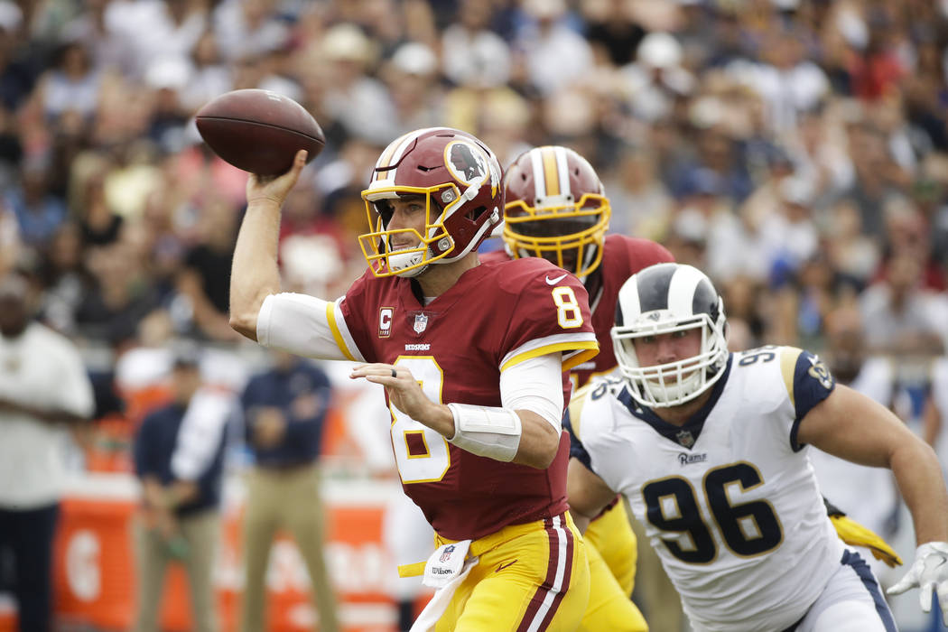Washington Redskins quarterback Kirk Cousins throws a pass during an NFL football game against the Los Angeles Rams Sunday, Sept. 17, 2017, in Los Angeles. (AP Photo/Jae C. Hong)