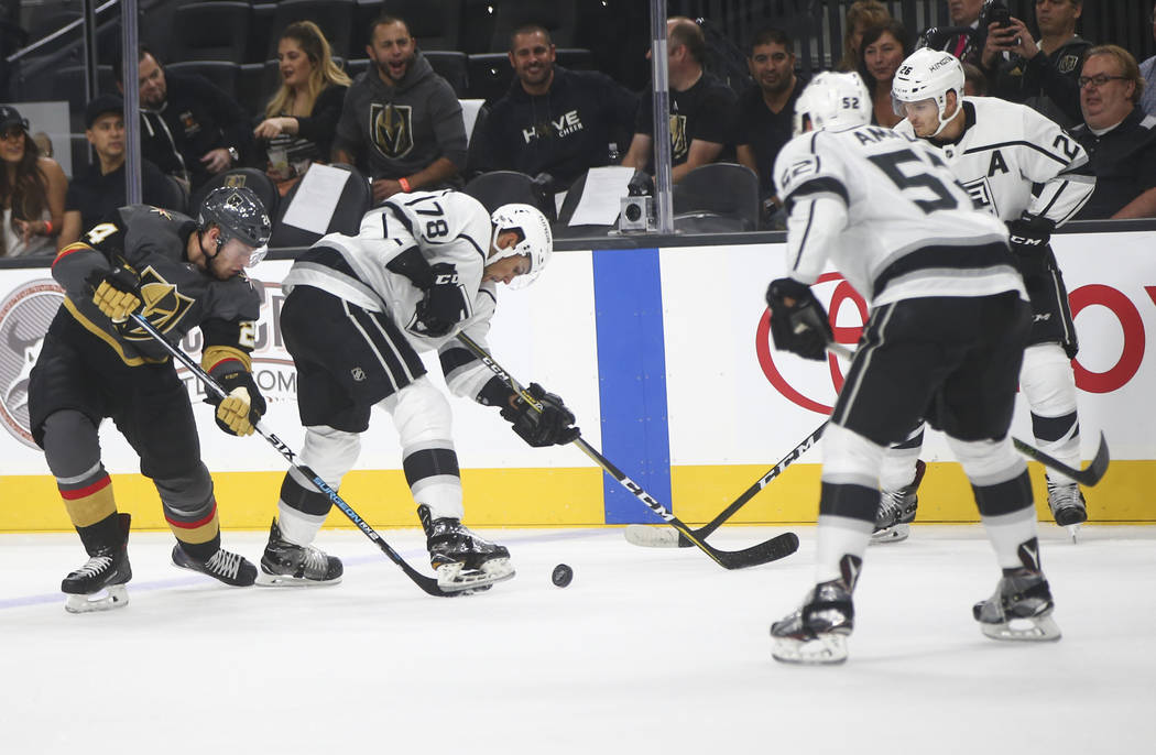 Golden Knights' Oscar Lindberg (24) fights for the puck against Los Angeles Kings' Alex Iafallo (78) during an NHL preseason hockey game at T-Mobile Arena in Las Vegas on Tuesday, Sept. 26, 2017.  ...