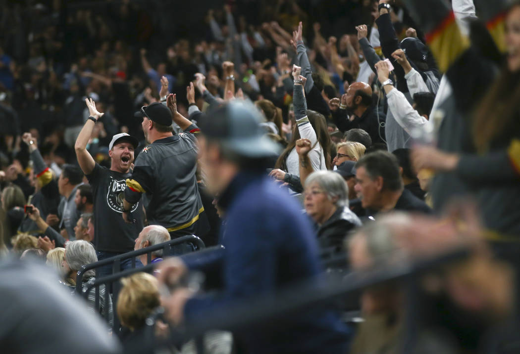 Fans cheer after the Golden Knights score their first goal against the Los Angeles Kings during an NHL preseason hockey game at T-Mobile Arena in Las Vegas on Tuesday, Sept. 26, 2017. Chase Steven ...