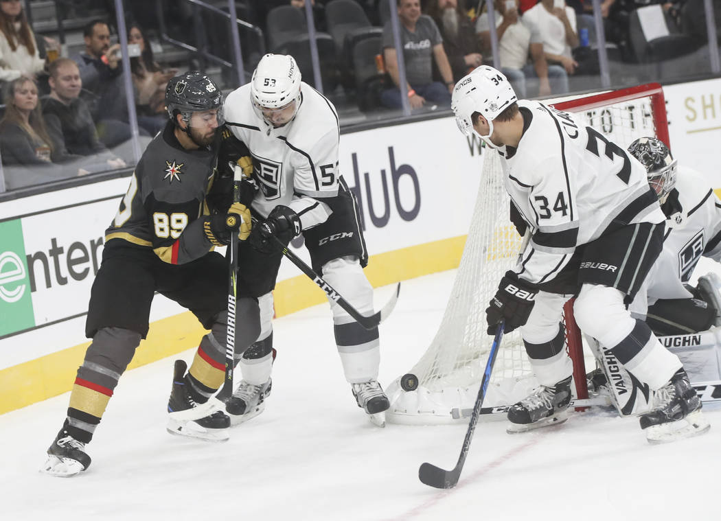 Golden Knights' Alex Tuch (89) fights Los Angeles Kings' Kevin Gravel (53) for control of the puck during an NHL preseason hockey game at T-Mobile Arena in Las Vegas on Tuesday, Sept. 26, 2017. Ch ...