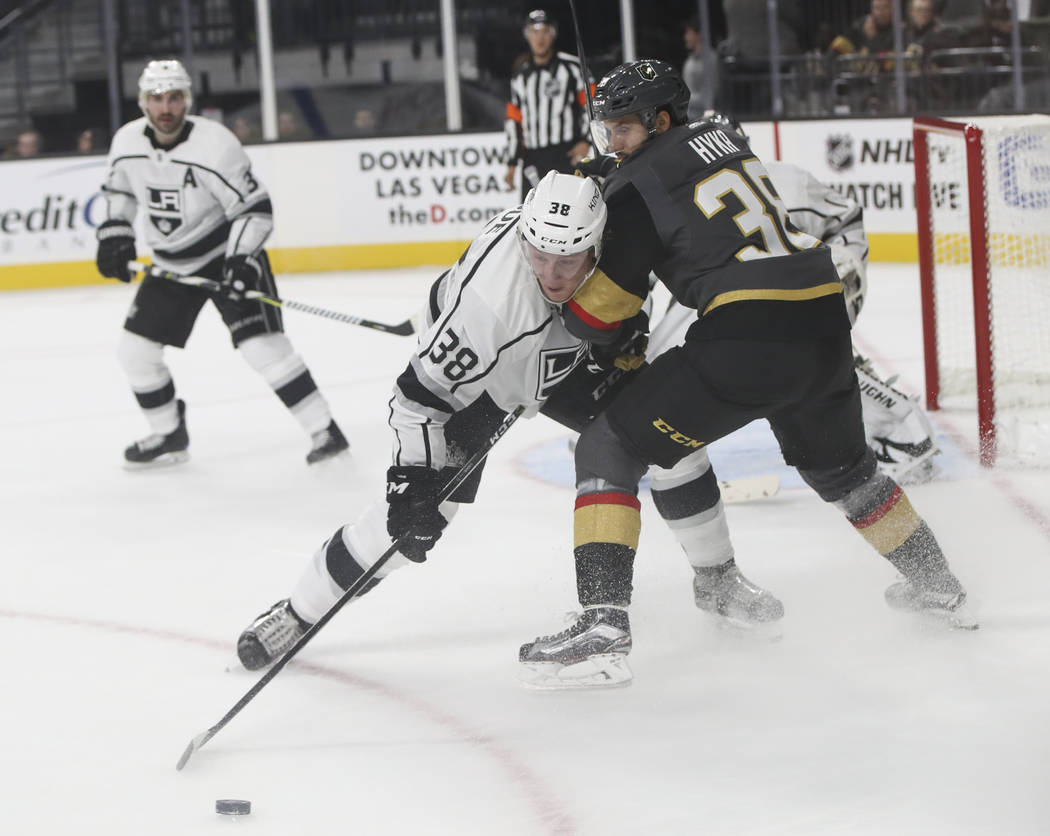 Los Angeles Kings' Paul LaDue, left, controls the puck over Golden Knights' Tomas Hyka during an NHL preseason hockey game at T-Mobile Arena in Las Vegas on Tuesday, Sept. 26, 2017. Chase Stevens  ...