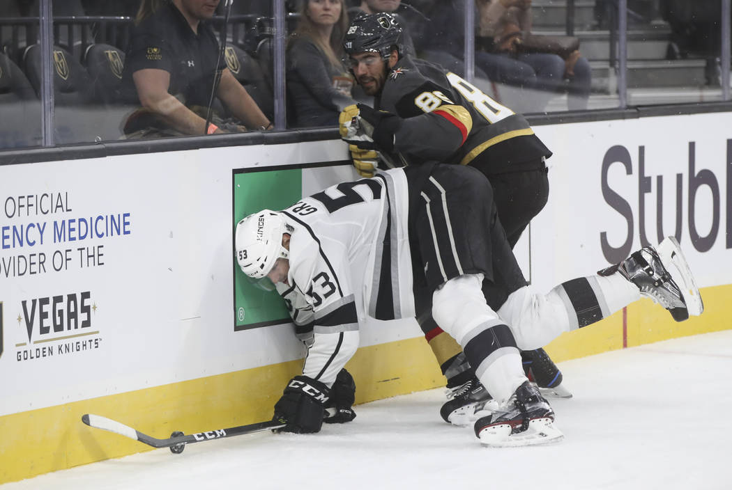Los Angeles Kings' Kevin Gravel (53) is tripped up by Golden Knights' Alex Tuch (89) during an NHL preseason hockey game at T-Mobile Arena in Las Vegas on Tuesday, Sept. 26, 2017. Chase Stevens La ...