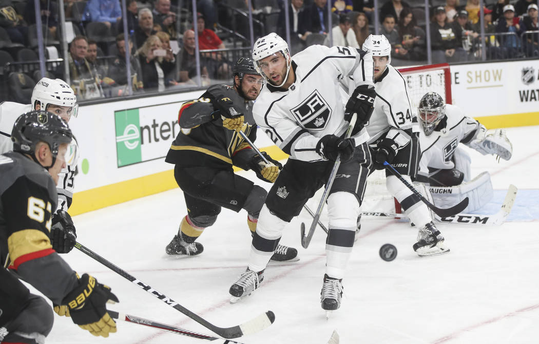 Los Angeles Kings' Michael Amadio (52) watches the puck fly by during an NHL preseason hockey game against the Golden Knights at T-Mobile Arena in Las Vegas on Tuesday, Sept. 26, 2017. The Kings w ...