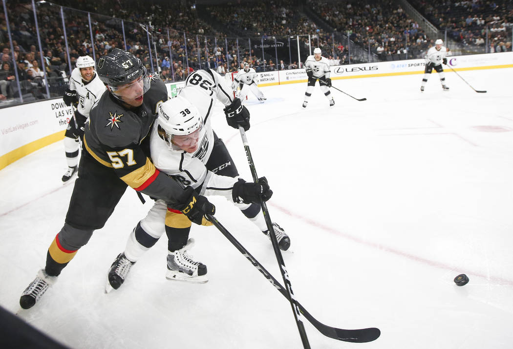 Golden Knights' David Perron (57) battles for the puck against Los Angeles Kings' Paul LaDue (38) during an NHL preseason hockey game at T-Mobile Arena in Las Vegas on Tuesday, Sept. 26, 2017. The ...