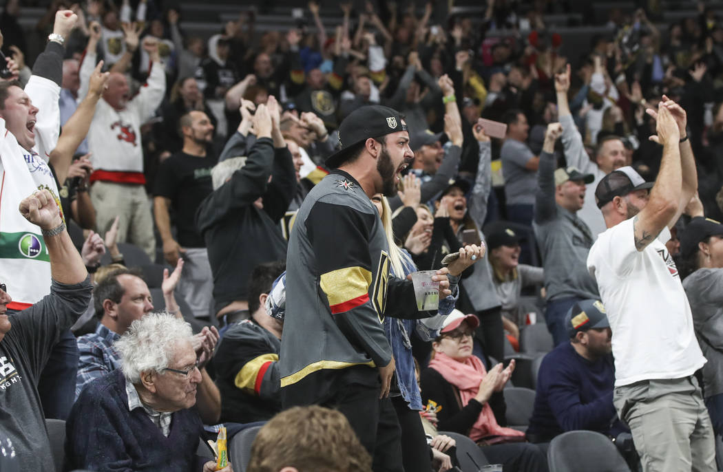 Golden Knights fans celebrate a goal by Golden Knights' William Carrier (28), not pictured, during an NHL preseason hockey game against the Los Angeles Kings at T-Mobile Arena in Las Vegas on Tues ...