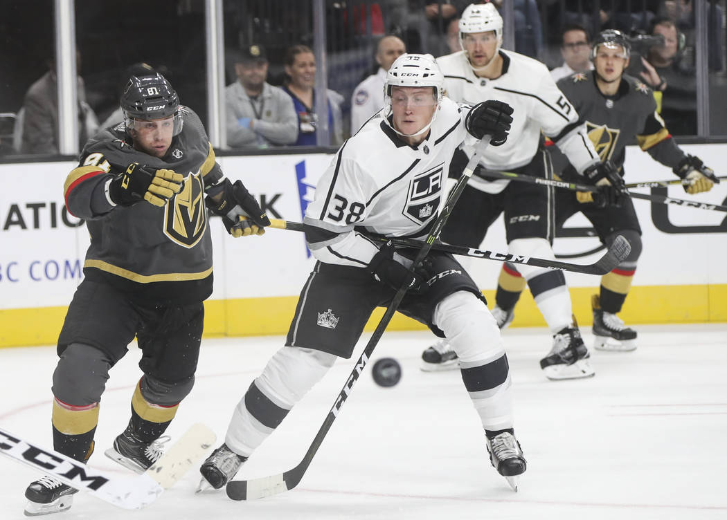 Golden Knights' Jonathan Marchessault (81) and Los Angeles Kings' Paul LaDue (38) watch the puck pass by during an NHL preseason hockey game at T-Mobile Arena in Las Vegas on Tuesday, Sept. 26, 20 ...
