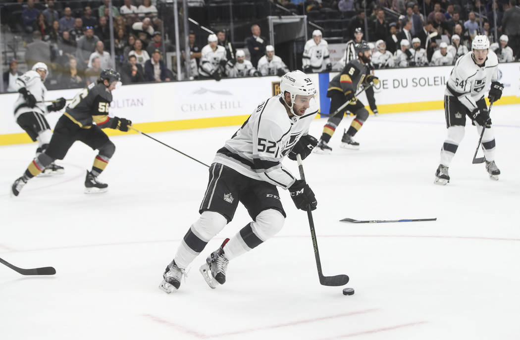 Los Angeles Kings' Michael Amadio (52) guides the puck during an NHL preseason hockey game against the Golden Knights at T-Mobile Arena in Las Vegas on Tuesday, Sept. 26, 2017. The Kings won 3-2 i ...