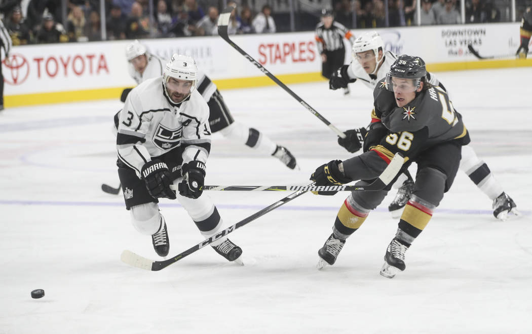 Los Angeles Kings' Chris Lee (3) and Golden Knights' Erik Haula (56) go after the puck during an NHL preseason hockey game at T-Mobile Arena in Las Vegas on Tuesday, Sept. 26, 2017. The Kings won  ...