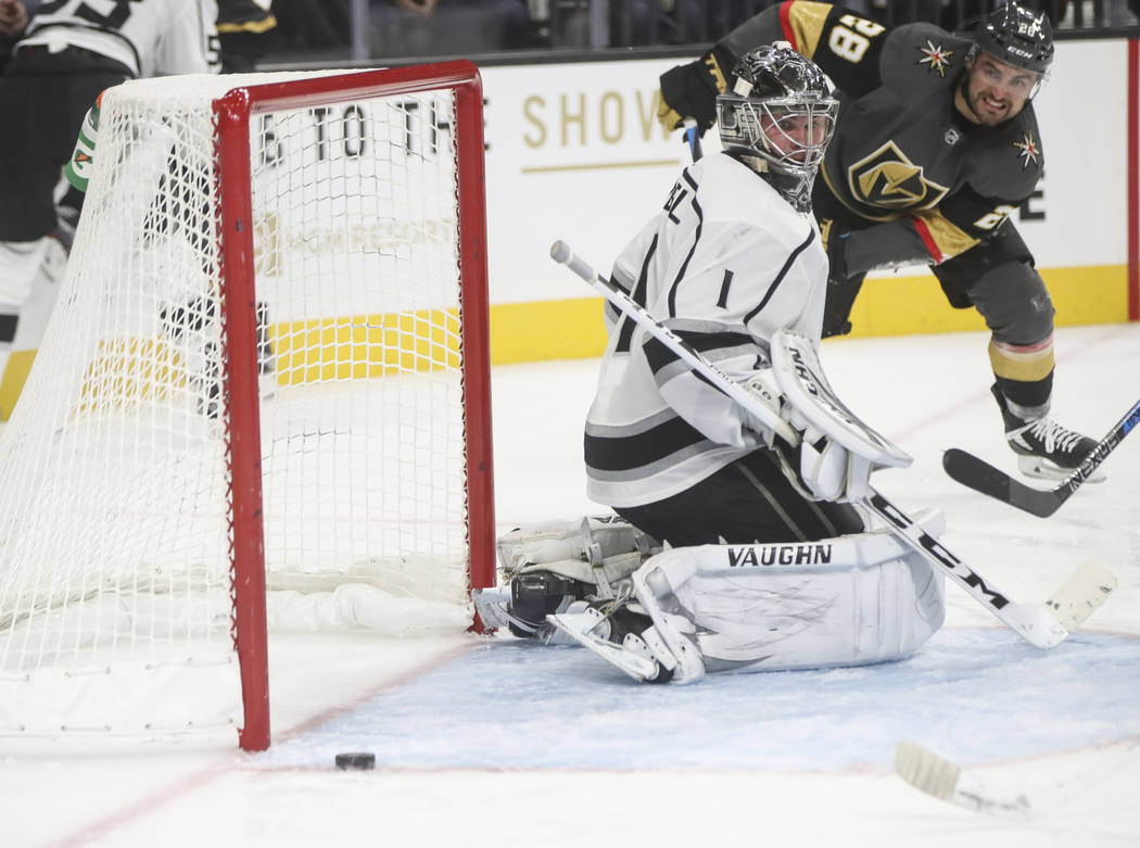 Los Angeles Kings goalie Jack Campbell (1) watches the puck narrowly miss the goal during an NHL preseason hockey game against the Golden Knights at T-Mobile Arena in Las Vegas on Tuesday, Sept. 2 ...
