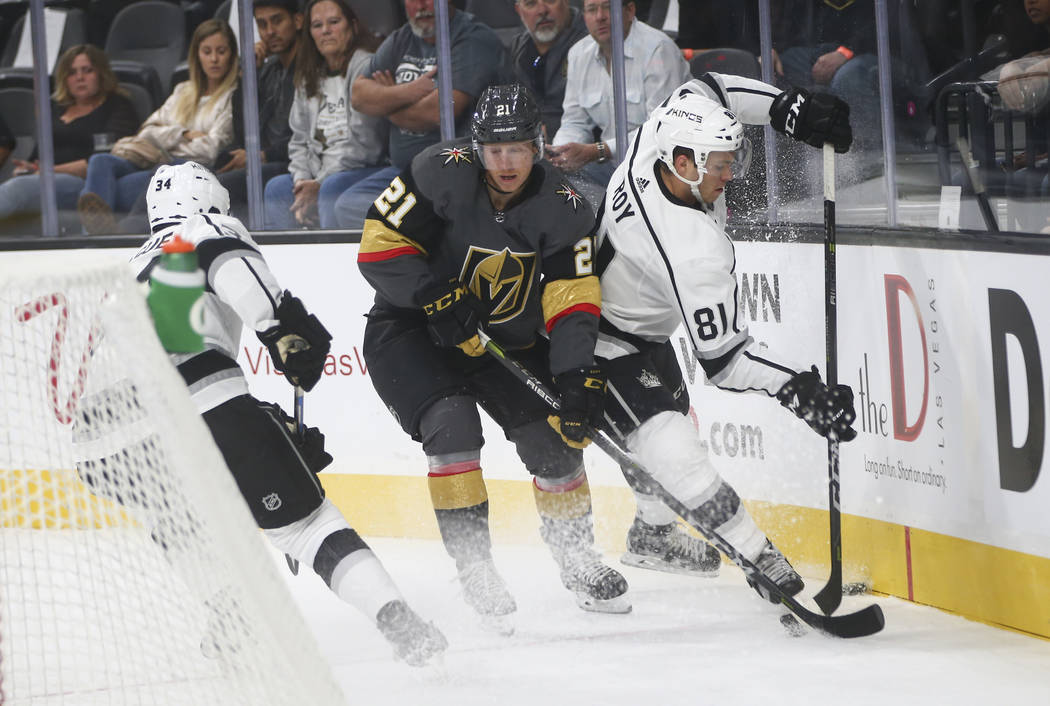 Golden Knights' Cody Eakin (21) battles for the puck against Los Angeles Kings' Matt Roy (81) during an NHL preseason hockey game at T-Mobile Arena in Las Vegas on Tuesday, Sept. 26, 2017. Chase S ...