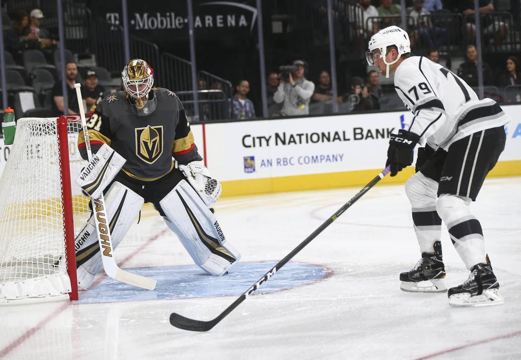 Golden Knights' Calvin Pickard (31) guards the goal as Los Angeles Kings' Justin Auger (79) looks on during an NHL preseason hockey game at T-Mobile Arena in Las Vegas on Tuesday, Sept. 26, 2017.  ...