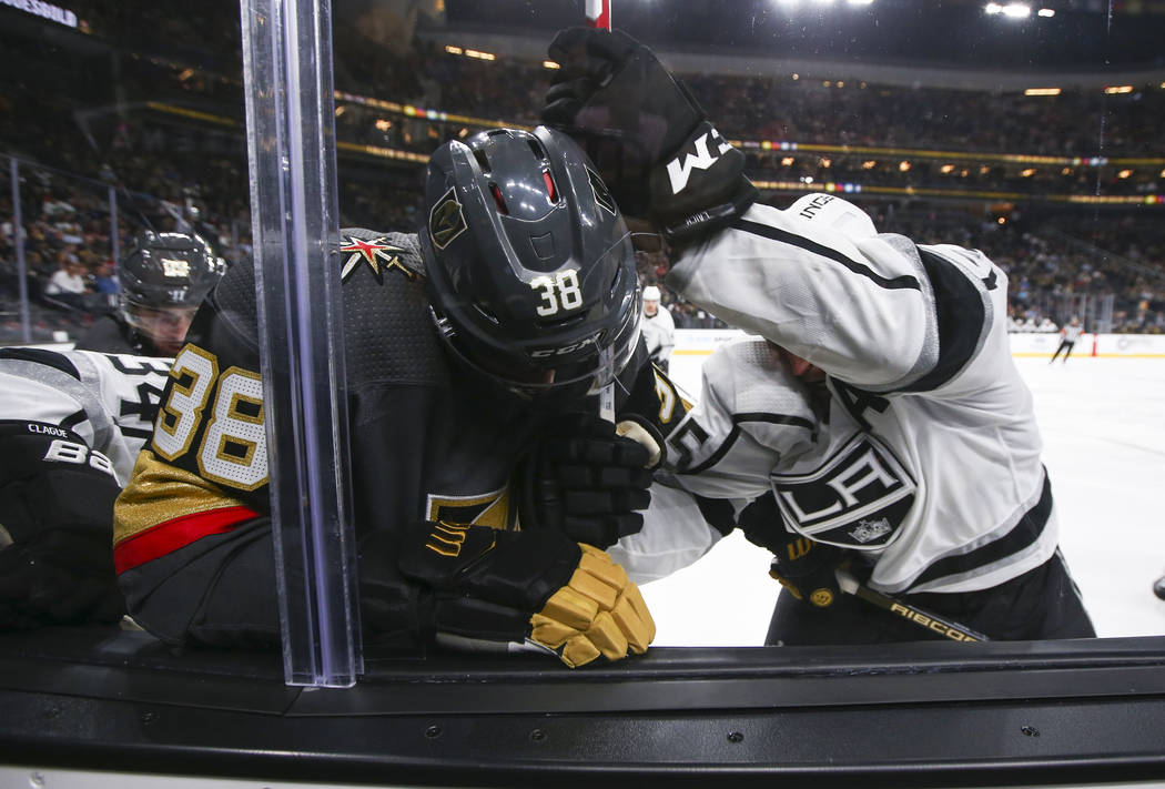 Golden Knights' Tomas Hyka (38) battles for the puck against Los Angeles Kings Brooks Laich during an NHL preseason hockey game at T-Mobile Arena in Las Vegas on Tuesday, Sept. 26, 2017. The Kings ...