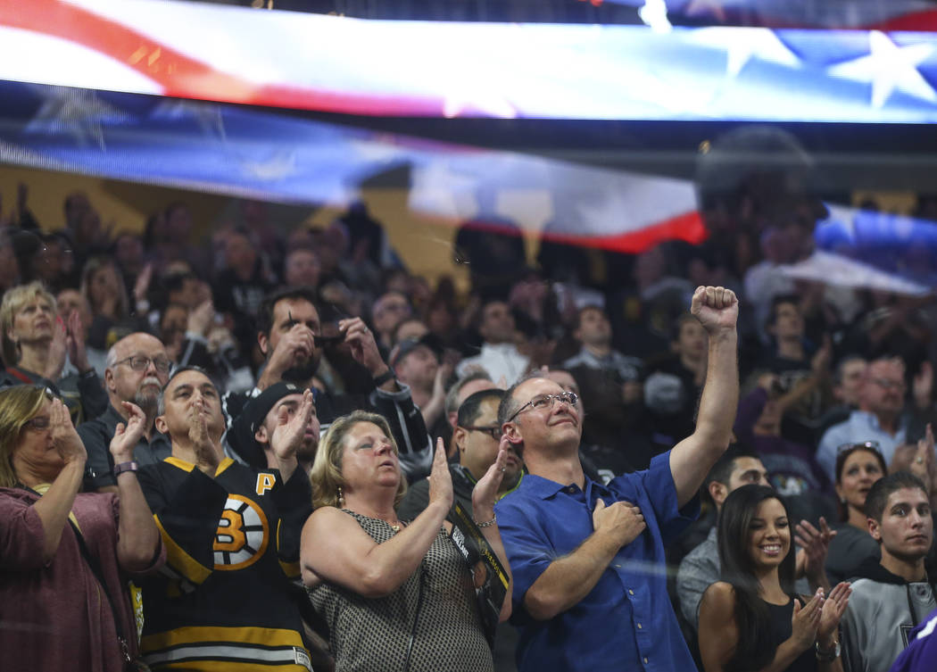 Fans cheer at the end of the national anthem before an NHL preseason hockey game between the Golden Knights and Los Angeles Kings at T-Mobile Arena in Las Vegas on Tuesday, Sept. 26, 2017. The Kin ...
