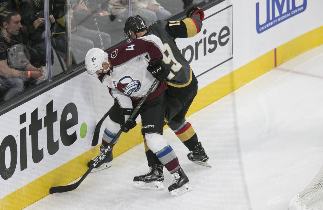 Colorado Avalanche defenseman Tyson Barrie (4) and Vegas Golden Knights right wing Reilly Smith (19) vie for the puck during the first period of a preseason NHL hockey game between the Vegas Golde ...