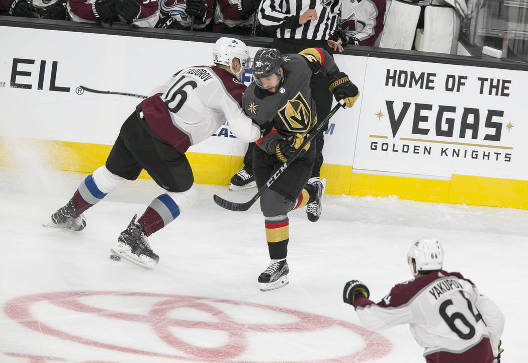 Colorado Avalanche defenseman Nikita Zadorov (16) and Vegas Golden Knights left wing Tomas Hyka (38) battle for control over the puck during the first period of a preseason NHL hockey game between ...