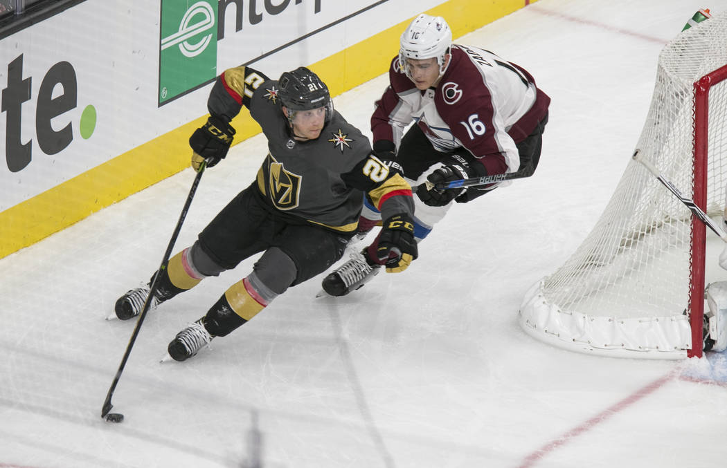 Vegas Golden Knights center Cody Eakin (21) is chased by Colorado Avalanche defenseman Nikita Zadorov (16) during the first period of a preseason NHL hockey game between the Vegas Golden Knights a ...